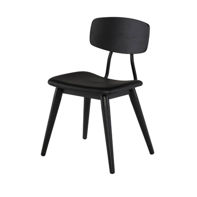 Retro inspired dining room chair with tapered legs in a black finish.