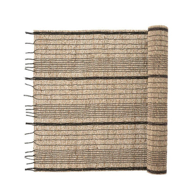 The Seagrass Table Runner - Charcoal is a woven table runner made from seagrass and charcoal cotton with a fringed edge.
