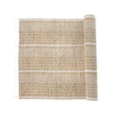 The Seagrass Table Runner - White is a woven table runner made from seagrass and white cotton with a fringed edge.