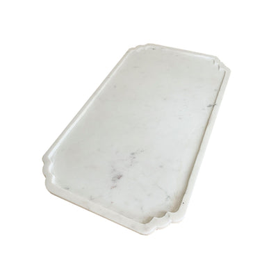 The Shiraz Large Marble Tray is a rectangle serving tray hand-carved from marble with unique scroll details.