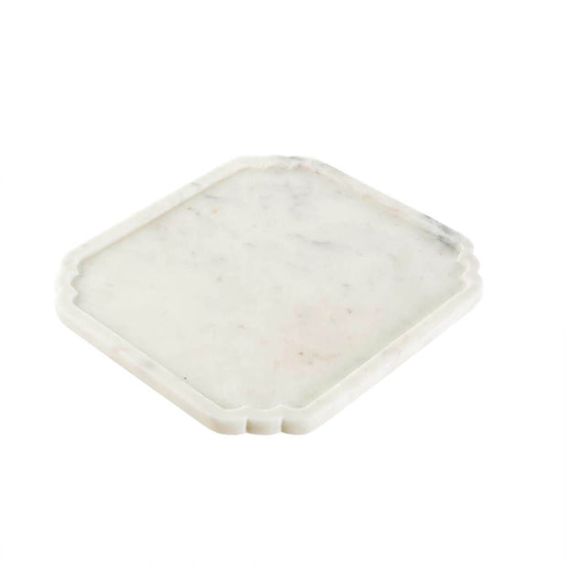 The Susa Marble Tray is a display tray hand-carved from solid, white marble.