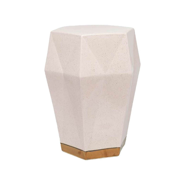 The Attiki Stool in pale rose finish with gold details in a geometric shape,