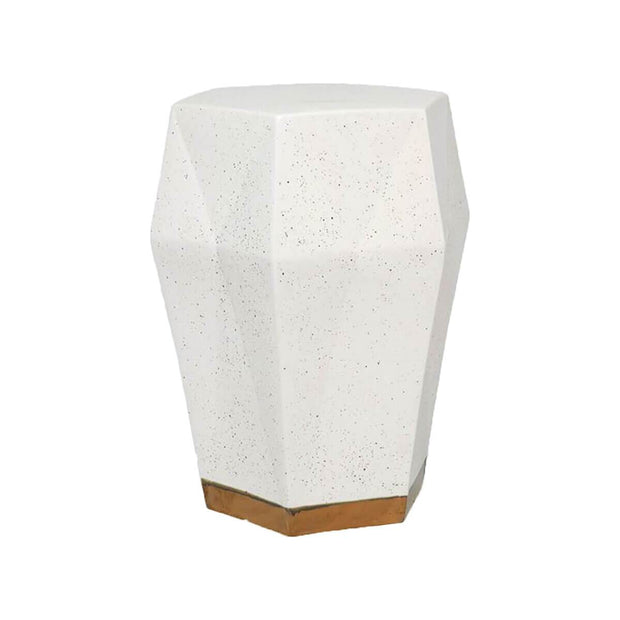 The Attiki Stool is a geometric ceramic stool with a white finish and gold details.