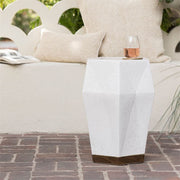 Modern gemstone inspired ceramic stool in an outdoor living space.