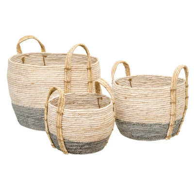 The Agate Storage Baskets are neutral storage baskets woven from grass with sturdy handles.