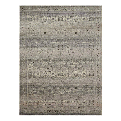 A textural rug that has been power loomed and created in Turkey. A mix of charcoal and grey neutral tones form this rug that has been carefully distressed.
