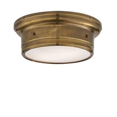 The Siena Flush Mount has a simple drum shape in a hand-rubbed antique brass finish with covered bolt details and a white glass diffuser