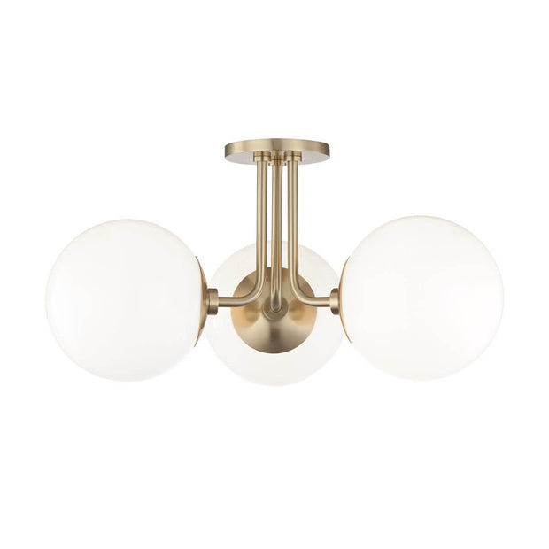 Alyeska Semi Flush. Semi flush bedroom lighting with a brass finish and milk glass globes.