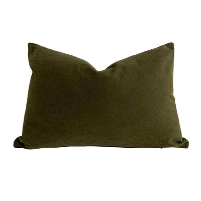 Dark green decorative pillow made from stonewashed cotton.