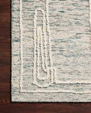 Geometric abstract design on hand tufted rug.