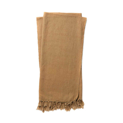 The Gobi Throw - Camel is a simple camel coloured, cotton and linen blanket with a fringe edge.