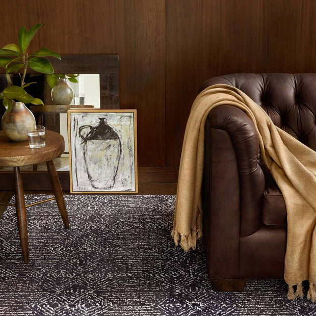 Camel coloured throw blanket in a masculine living room.