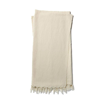The Gobi Throw - Ivory is a simple ivory coloured, cotton and linen blanket with a fringe edge.