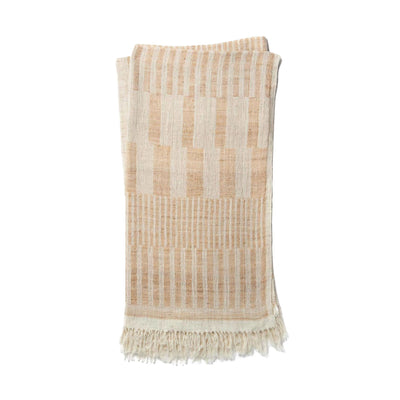 The Tejada Throw - Ivory / Beige is a luxurious, wool and silk blend throw blanket with an ivory and beige ancient tribal pattern.