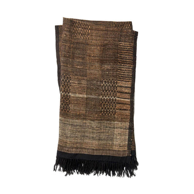The Tejada Throw - Beige / Black is a wool and silk blend throw blanket with a black and beige tribal pattern.