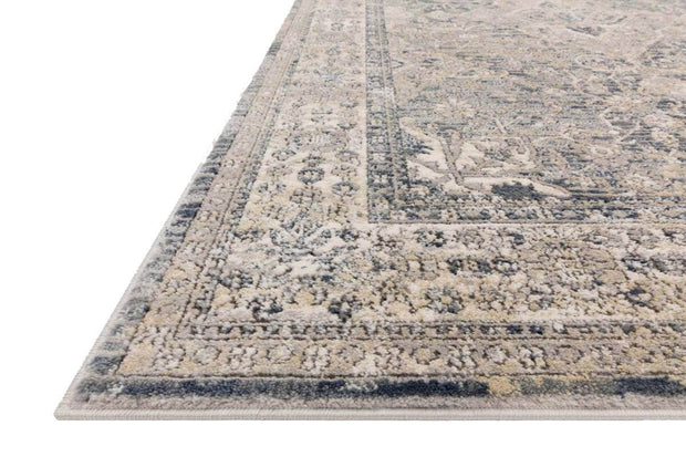 Affordable rug with a light blue and brown vintage inspired pattern.