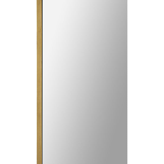 Thin gold leaf frame on the minimal full-length mirror.