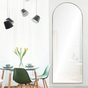 Glam arched frame in a modern dining room.