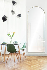 Dining room featuring a full length, arched mirror.