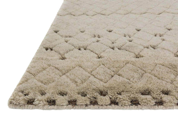 Light brown wool and jute neutral pattern rug.