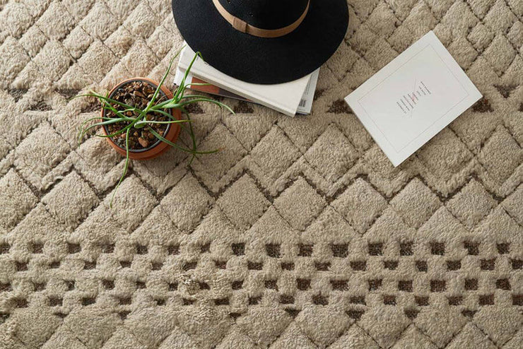 Arusha Sand Rug. Neutral, high-low geometric pattern rug with a tribal feel.