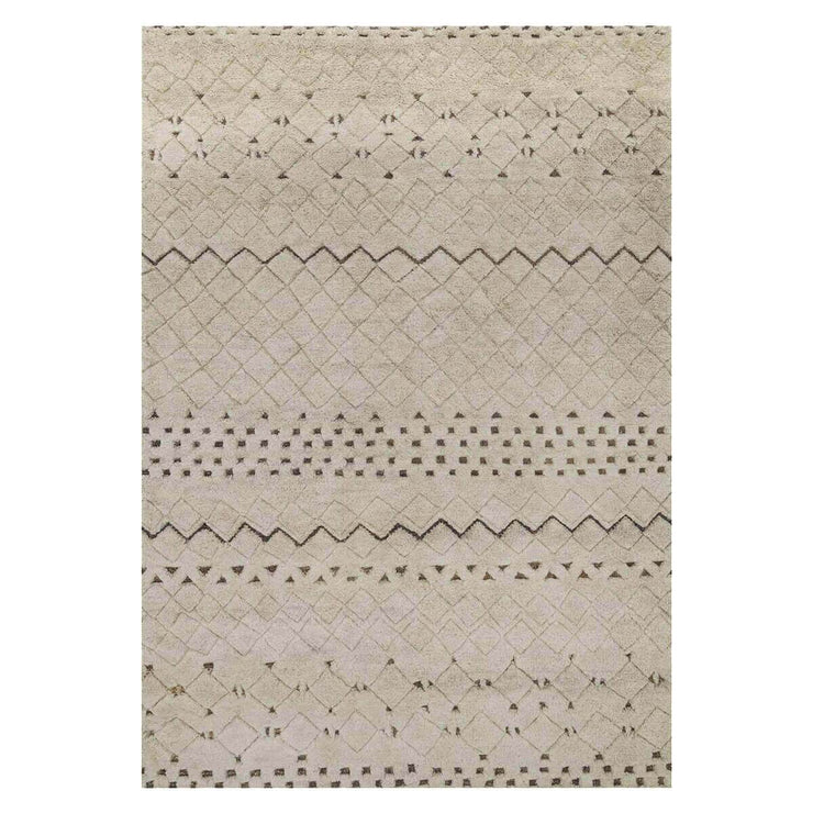Arusha Sand Rug. Wool and jute rug with a geometric tribal pattern.