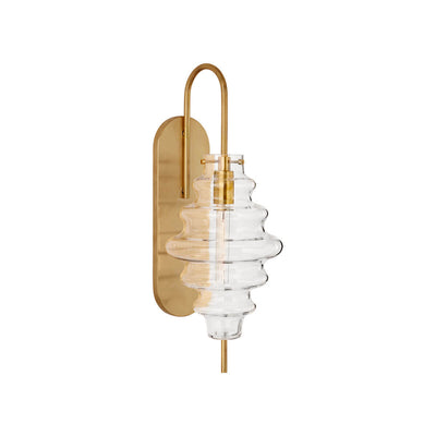 The Tableau Wall Sconce has an antique burnished brass backplate and hooked arm with a clear glass rippled lamp shade.
