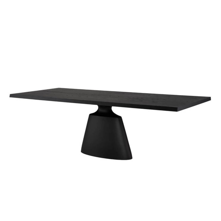 Modern dining table with a sleek, architectural shape and dark onyx finish.