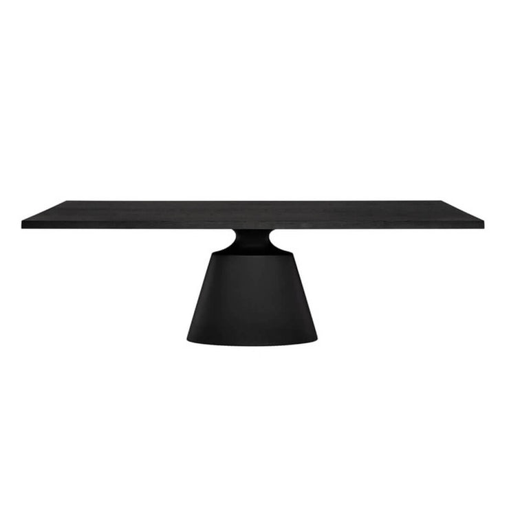 Dining table with a stand-alone architectural base and a floating top in a dark onyx tone.