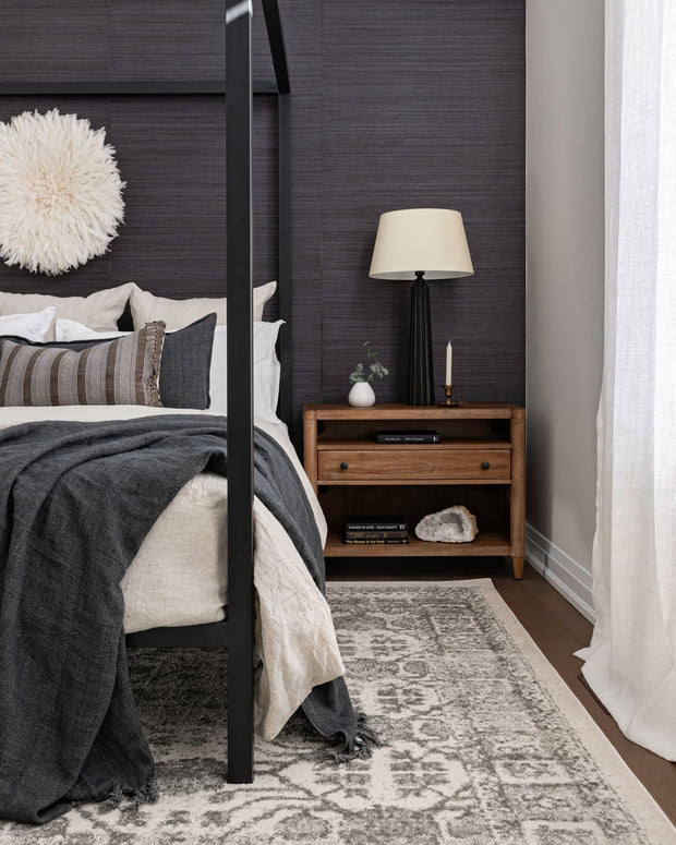 Tamra Ivory/ Grey Rug in a bedroom. Traditional ivory / grey rug in bedroom.