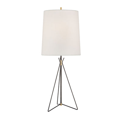 The Tavares Large Table Lamp is a large iron table lamp with a slim, aged iron base in a geometric shape with a white lamp shade.