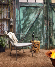 Teak root stool in an outdoor living space.