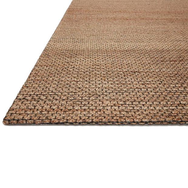 Earthy, natural beige-toned textural jute rug close up image. Handwoven rug.