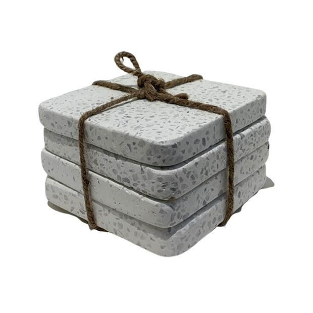 The Terrazzo Coaster Set is a set of four square, grey terrazzo coasters.