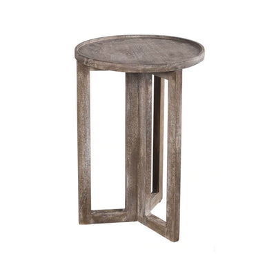 The Marassi Large Side Table has a round top and tall, geometric legs and is made from solid wood.