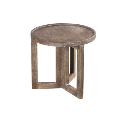 The Marassi Small Side Table is a round, solid wood table with geometric legs and texture variations.