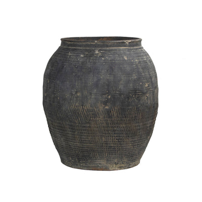 Antique large water pot from China with rustic textural details.