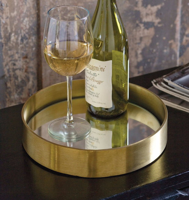 Glam serving tray holding a wine bottle and glass.