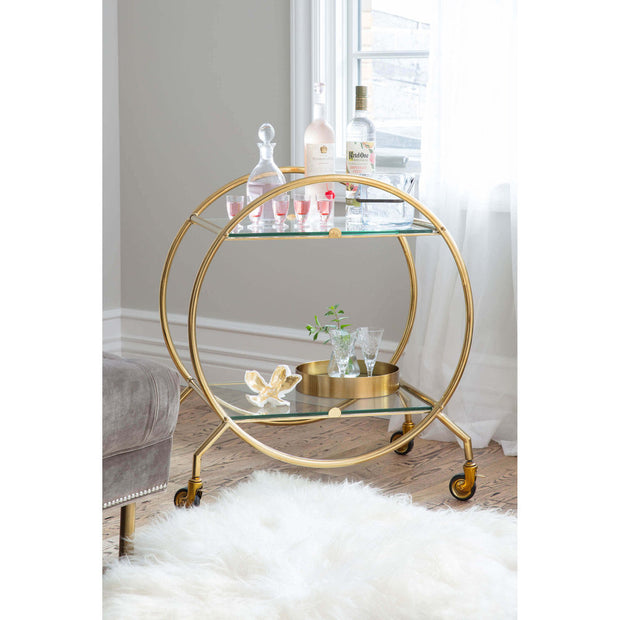 Round serving tray on a midcentury modern bar cart.