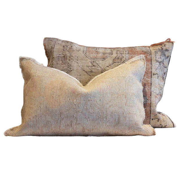 Hand-crafted, rectangular pillow made from a vintage rug.