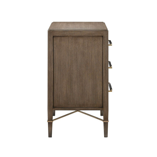 Side view of a brown and gold nightstand with an x-shaped leg brace detail.