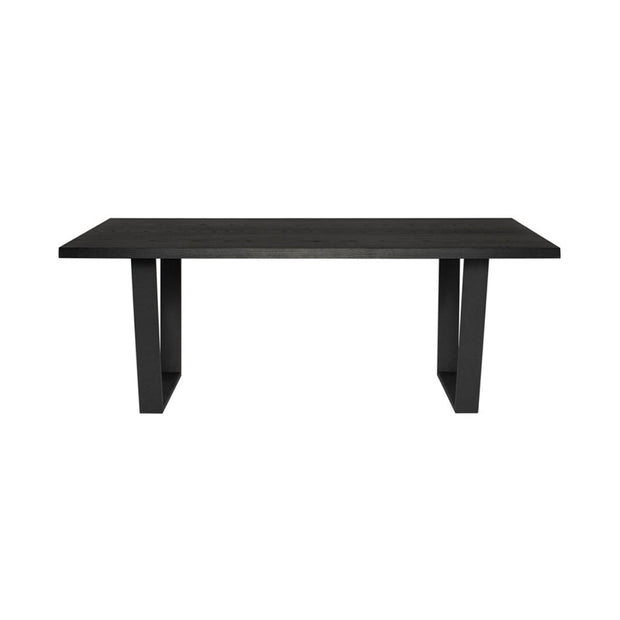 The Laval Dining Table has oak wood table top and steel, square legs in a black finish.