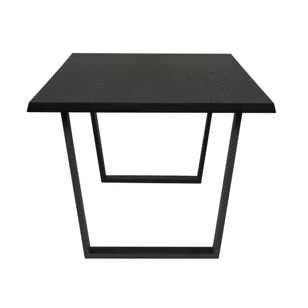 End view of the geometric black steel legs and wood veneer table top on the Laval Dining Table.
