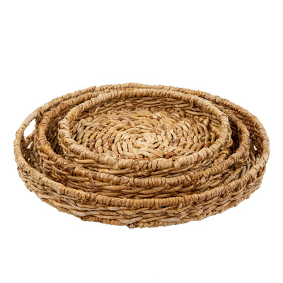 The Viento Trays are made of woven abaca in a natural finish. These trays come in a set of three.