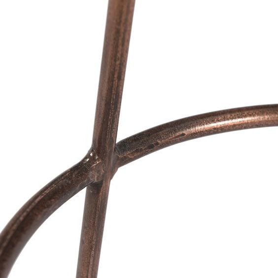 Copper metal tube base on the backless, farmhouse stool.