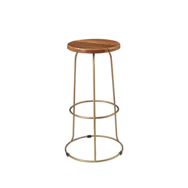 Farmhouse style bar stool with a brass pedestal base and teak wood backless seat.