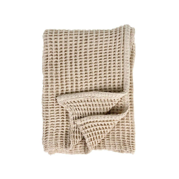 The Hobart Throw is a light brown, waffle weave throw blanket.