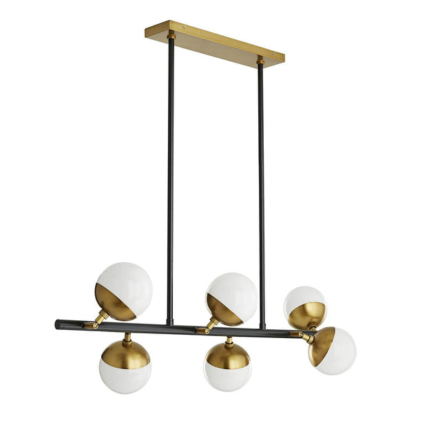 Modern chandelier with brass accents and asymmetrically placed glass spheres.