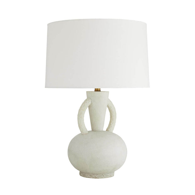The white Laurier Table Lamp with a vase-shaped faux marble base and embossed details