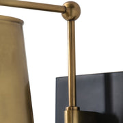 Antique brass arm and details of the Polastsk Wall Sconce.